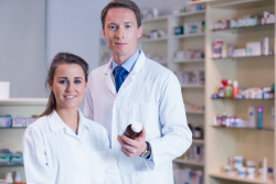 female and male pharmacist smiling