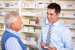 pharmacist serving the elderly person in pharmacy